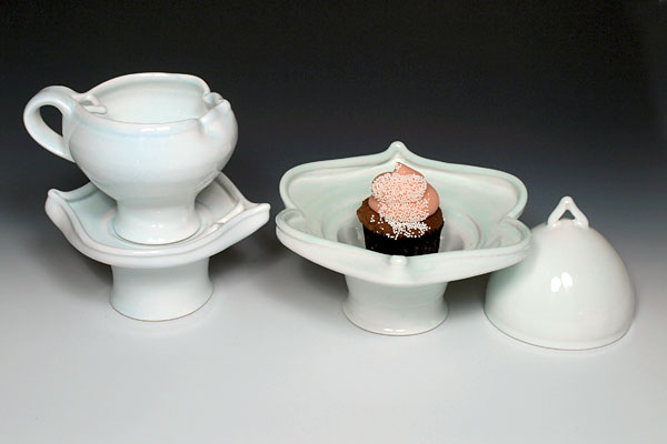 Drink and Dessert Setting for One Serving a Cupcake, 2012